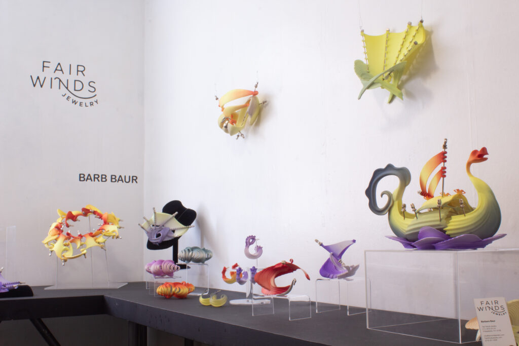 Colorful 3D printed jewelry pieces on display